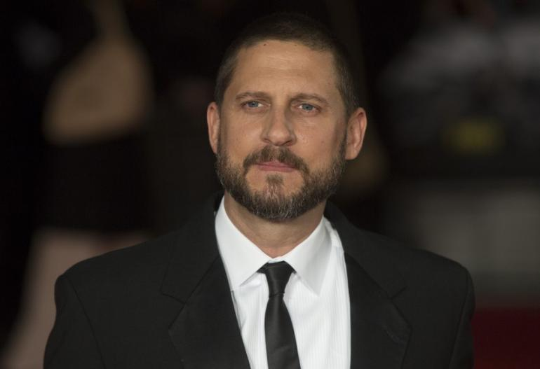 455714-director-david-ayer-poses-before-a-gala-screening-of-his-film-fury-in