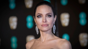 Mandatory Credit: Photo by Vianney Le Caer/Invision/AP/REX/Shutterstock (9421617ja) Angelina Jolie poses for photographers upon arrival at the BAFTA Film Awards, in London Britain BAFTA Awards 2018 Arrivals, London, United Kingdom - 18 Feb 2018